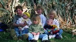Michael, Mary Emeline, Carleen, Clara, Torie, and Jonas at the pumpkin farm in October, 1999. (original Manda Baldwin)