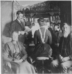 The caption on the back indicates this is Francis with Bertha at the organ and Lindsay on the right. The couple in front are unidentified. (Original: Janet Lucius)