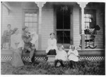 Lindsay sitting on porch, then Lucy, Francis holding June, Esther, Ruth, and Marion.  Picture taken at Benjamin and Ida Boughton's house in Bear Valley, around 1908. This picture was duplicated from the original by William Bundy circa 1960, and thus has less fading. (Original: Janet Lucius)
