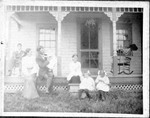 Lindsay sitting on porch, then Lucy, Francis holding June, Esther, Ruth, and Marion.  Picture taken at Benjamin and Ida Boughton's house in Bear Valley, around 1908. Scanned from an original in 2004.  (Original: Mary Hundeby.)