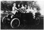 This is the Francis Bundy family's first car, a 1914 Ford. On the right are William and June in the car, with Lucy standing next to none other than Aunt Josie! On the far left is Marion or Ruth. About 1915. (Original: Janet Lucius)