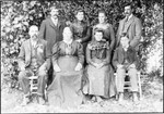 "Andrew and Anna Mattson (sitting, front left) and their children. In 1900, Annie was listed as having six living children. Clara is third from left in the front row. Based on comparison with a picture postcard of ""Mrs. C. Olson"", the woman standing second from left is Mary. Based on the 1900 census, the two men standing are Andrew and Annie's sons, Andrew and Alfred. The youngest son must be Victor, also based on the 1900 census. Victor is known from census data and his WWI draft registration card to have lived with his sister Mary in Washington State. Bob Winberg's address book from 1930-1940 contains addresses all on one page for 1) Mrs. Bjorling (Mary Mattson; her second husband was Eric Bjorling) of Everett, Washington, 2) Victor Mattson, of Monroe Washington, and 3) a Mrs. Thomas Oline, of Tacoma, Washington, who is found listed along with Emily Mattson as the parents of Lawrence Robert Oline, born to them in King County, Washington. The Olines are found in the 1930 census of Tacoma at the same address listed in Bob Winberg's address book. So the woman in back second from right was Emily. That accounts for all six living children. Since Victor was born in 1890, the picture appears to date from around 1900. (Original: Mary Hundeby)"