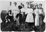 William is standing, third from left. Lucy is front right, probably holding her daughter June. Standing fourth from left is Alice Cater (granddaughter of Thomas Jefferson Bundy), and standing leftmost is Savilla (Bundy) Russell, with probably her daughter Bessie in front of her. (Original: Janet Lucius)