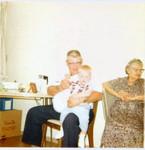 Bob Hart on the lap of Bob Winberg, next to Bob Winberg's mother Clara Winberg (Original: Mary Hundeby)