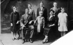 The Winberg family around 1925-27.  The boys in back are (left to right) Raymond (youngest), Claus (oldest), and Bob.  Charles and Clara in front with Edith in the middle (youngest).  Judging by height, the girl on the left is Esther, the one on the right is Anna (oldest).  (Original: Bob Hart, Bob Winberg's USS Maryland Scrapbook)